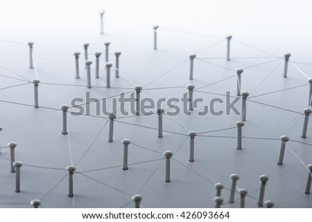 Linking entities. Network, networking, social media, connectivity, internet communication abstract. A small network connected to a larger network. Web of thin silver wires on white background.