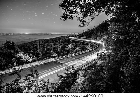 linn cove viaduct in blue ridge mountains at night - stock photo