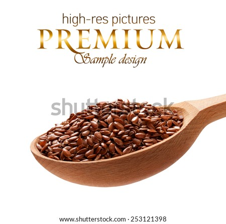 Linseed in a wooden spoon / cereal on wooden spoons isolated on white background with place for your text  - stock photo