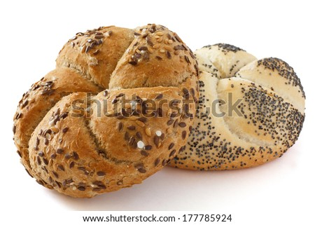 Linseed kaiser bread roll with salt crystals and a white poppy seed roll - stock photo