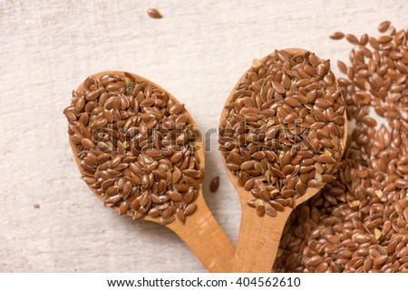Linseeds on a white wooden background.