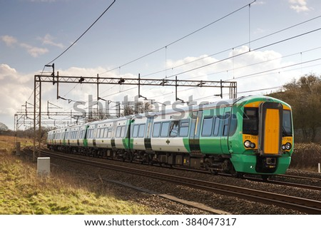 LINSLADE, UK - FEBRUARY 23: A Southern operated EMU passes Linslade on route to Milton Keynes on February 23, 2016 in Linslade. Southern call at 213 stations and operate a fleet of 297 units in the UK