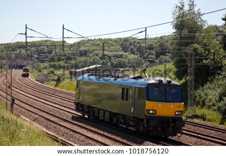 LINSLADE, UK - JUNE 30: A class 92 electric loco which operates on the Caledonian overnight sleeper service heads back to its London depot after a test run on June 30, 2015 in Linslade