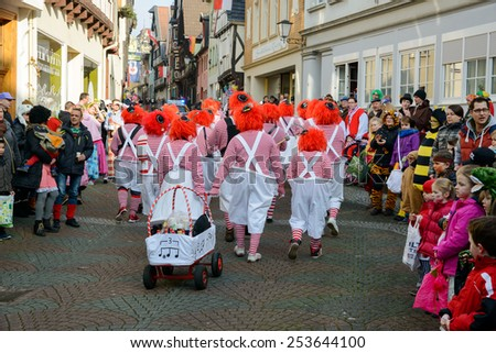 LINZ AM RHEIN, GERMANY 16 FEBRUARY 2015 - Unidentified persons celebrating a carnival procession to celebrate the end of Karneval season, an annual event held throughout certain regions in Germany