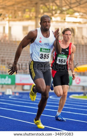 LINZ, AUSTRIA - AUGUST 1 Austrian track and field championship: Ryan Moseley (#385) wins the mens's 100m competition on August 1, 2009 in Linz, Austria.