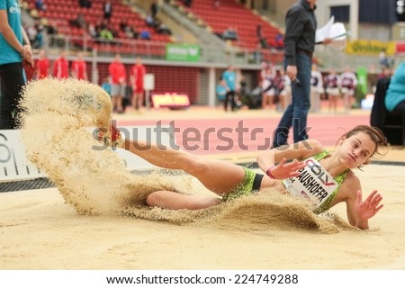 LINZ, AUSTRIA - JANUARY 30, 2014: Marina Kraushofer (#604 Austria) places 6th in the long jump team event in an indoor track and field meeting. - stock photo