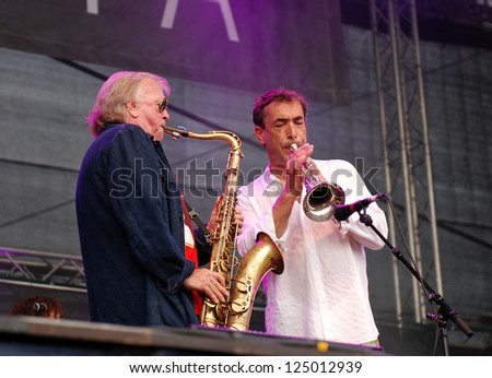 LINZ, AUSTRIA - JULY 3: German saxophonist Klaus Doldinger performs with Austrian musician Hubert von Goisern at the Linz Europa Hafenfest on July 3rd 2009 in Linz, Austria.
