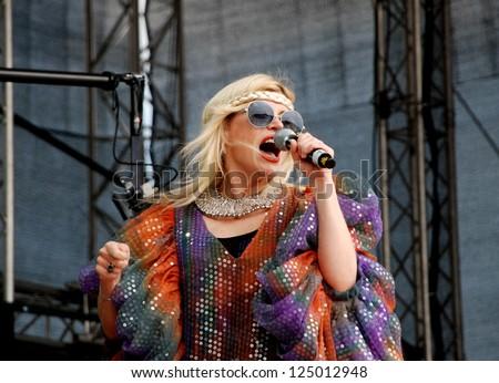 LINZ, AUSTRIA - JULY 4: Romanian star Loredana Groza sings on stage at the Linz Europa Hafenfest on July 4th 2009 in Linz, Austria. - stock photo