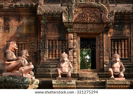 Lion and Monkey Gardians Carvings at Banteay Srei Red Sandstone Temple, Cambodia - stock photo