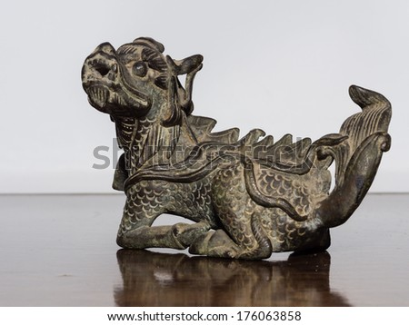 Lion chinese style made of bronze (Qilin Kylin or Kirin), one of the nine sons of dragon. - stock photo