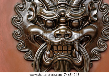 lion door lock - stock photo