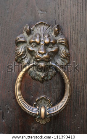 Lion head, brass door knocker - stock photo