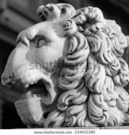 lion head sculpture - detail of pedestal of statue Hercules and Cacus  by Baccio Bandinelli on Piazza della Signoria in Florence, Italy, Europe - stock photo