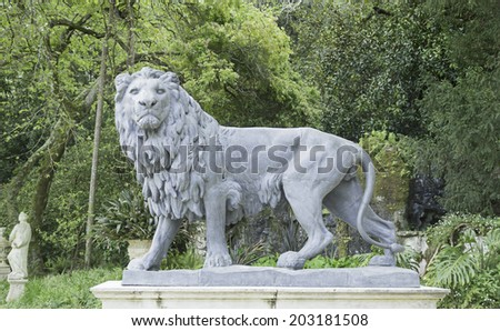 Lion in Lisbon in natural park, sculpture and history - stock photo