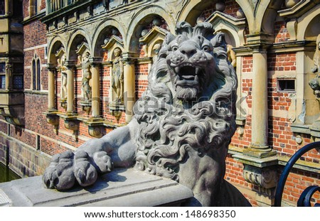 Lion monument at the Frederiksborg Palace - stock photo