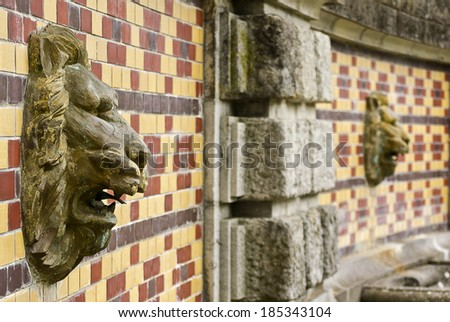 lion mural on the wall in a city park. - stock photo