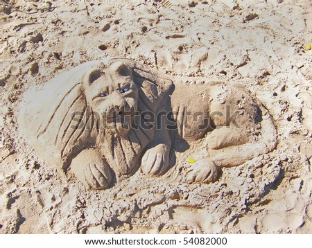 Lion sand sculpture on the beach
