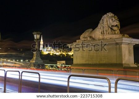 Lion sculpture detail part fo the Chain Bridge over Danube river, Budapest cityscape, Hungary - stock photo