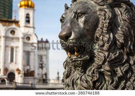 Lion sculpture in front of Cathedral of Christ the Savior in Moscow, Russia - stock photo
