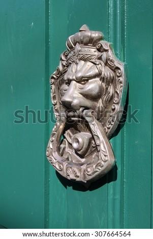Lion shaped door knocker in Matanzas, Cuba. - stock photo