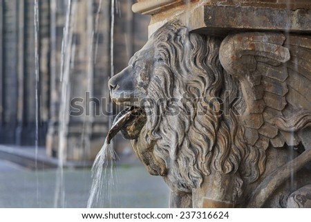 Lion statue and fountain on the square near Cologne cathedral, Germany  - stock photo