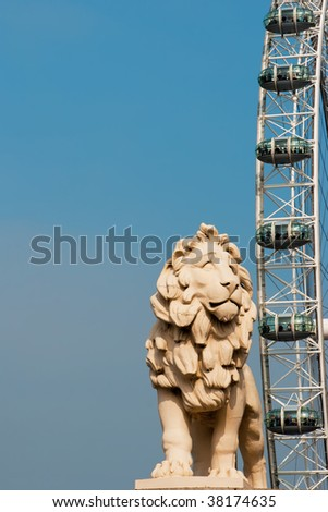 Lion statue and Millennium Wheel, London - stock photo