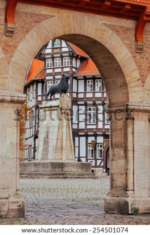 Lion statue and old timbered house in Braunschweig patio, Germany  - stock photo