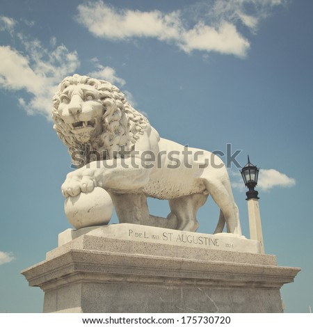 Lion Statue at the Bridge of Lions in St Augustine, FL, USA with retro effect - stock photo