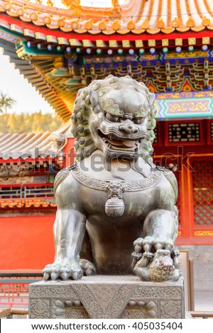 Lion statue at the Summer Palace complex, an Imperial Garden in Beijing. UNESCO World Heritage. - stock photo