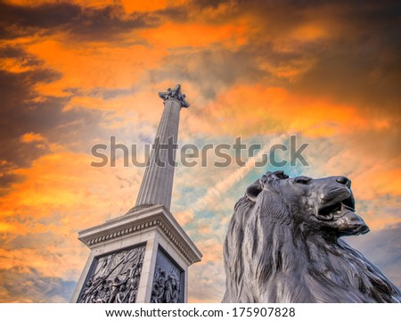Lion Statue at Trafalgar Square against dramatic sky, London, UK. - stock photo