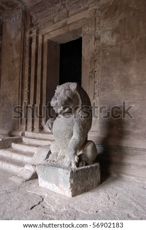 Lion statue, Hindu temple, Elephanta caves A large stone statue of a lion guarding one of the ancient Hindu temples in the caves on Elephanta Island off the coast of Mumbai, formerly Bombay, India. - stock photo