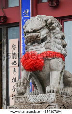 Lion statue in buddhist Qibao Temple near Qibao Ancient Town in Minhang District, Shanghai, China