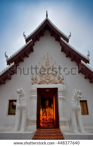 lion statue in front the sanctuary,  Nan, northern of Thailand, cloudy  - stock photo