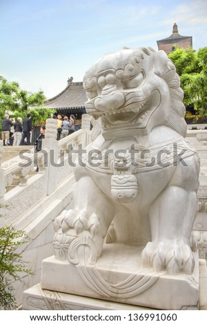 Lion statue in marble in the Da Ci'en Temple, X'ian, China - stock photo