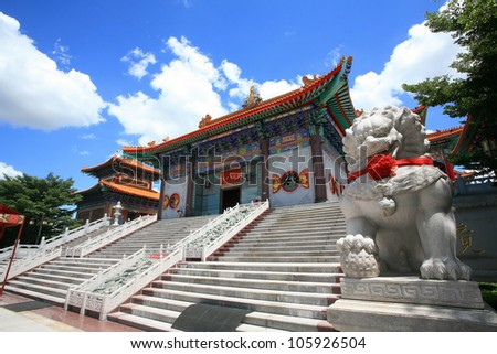 Lion statue located in front of Chinese temple, wat Leng-Noei-Yi against blue sky in Nonthaburi province, Thailand