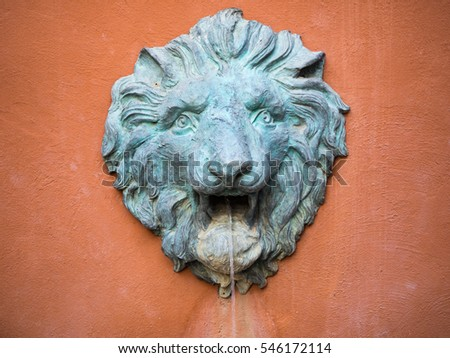 Lion statue on the wall