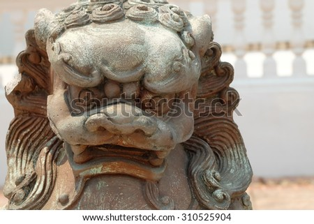 lion statue, symbol of protection and power in oriental asia especially china