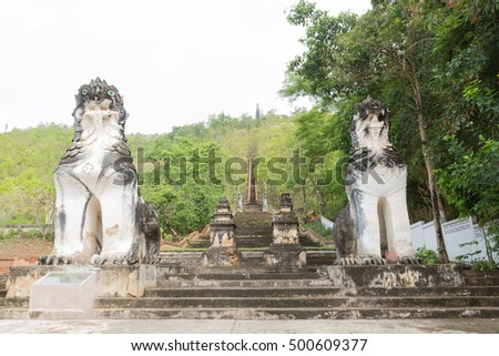Lion statues at the couple walked up the stairs to the temple on the mountain.