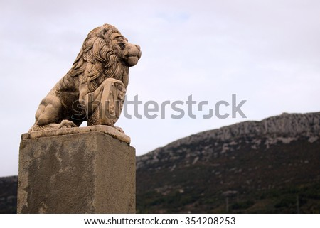 Lion with a shield to protect a mountain in Croatia