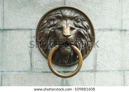 Lionhead old door knocker - stock photo