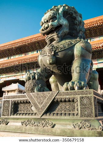 Lions closeup on Tiananmen Square near Gate of Heavenly Peace- the entrance to the Palace Museum in Beijing (Gugun) against the clear and blue sky - stock photo