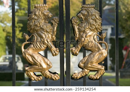 Lions Coat of Arms on front gate of a mansion of Newport Rhode Island - stock photo