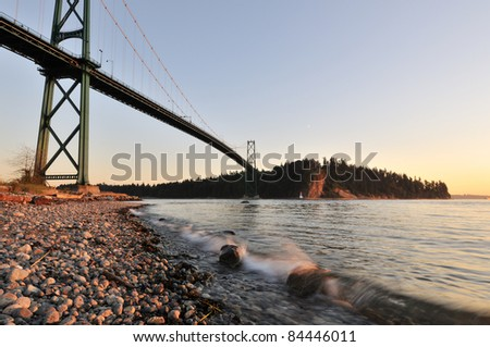Lions Gate Bridge at sunset with crescent moon
