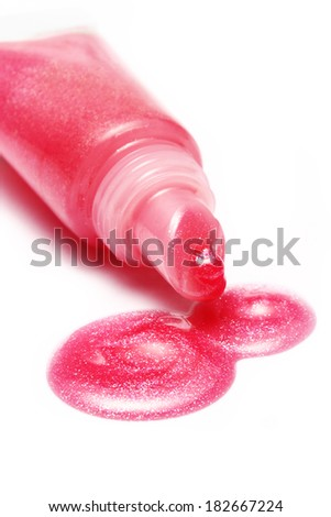 lip gloss pink color from tube on white background