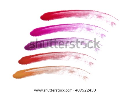 Lip gloss strokes on white background