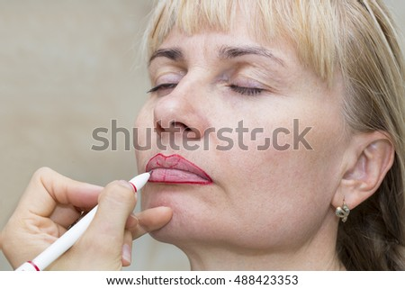 Lip tattoo woman in a beauty salon process