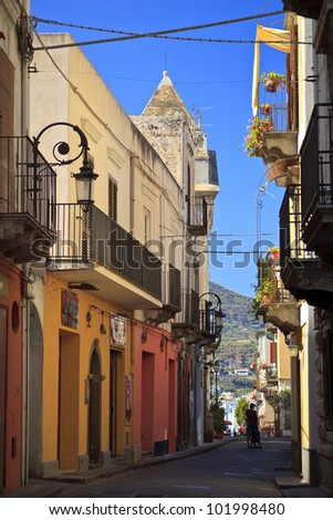 Lipari street with multicolored houses - stock photo