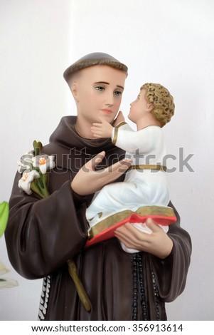 LIPIK, CROATIA - MAY 07: Saint Anthony of Padua holding baby Jesus, statue in the Church of Saint Francis of Assisi in Lipik, Croatia on May 07, 2015 - stock photo