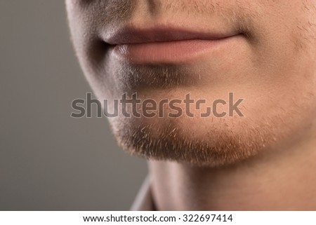 Lips and beard of young and handsome businessman - stock photo