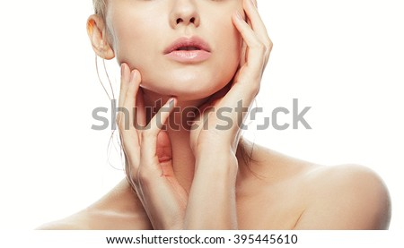 Lips and shoulders of young caucasian woman with natural make-up, perfect skin isolated on white. Studio portrait. Toned - stock photo